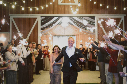 Bride and groom make their exit at Rockin' R Ranch in Bokchito, Oklahoma