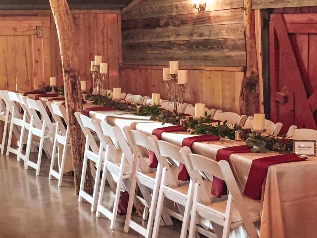 long wedding reception table decorated for winter