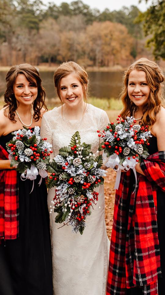 bridesmaids at winter wedding with scarves and winter bouquets