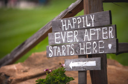 """Photo of a Sign That States, """"Happily Ever After Starts Here,"""" at One of the Best Barn Wedding Venues in North Texas."""