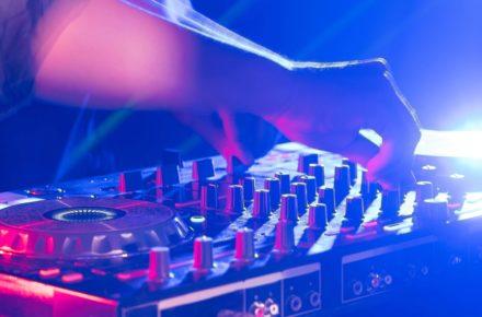 A close up photo of a a DJ offering wedding DJ Services.